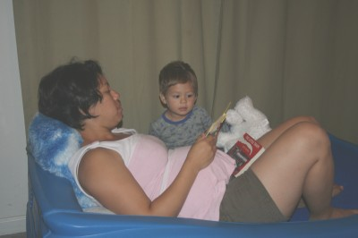 Kimi & Sammy, reading a story, on Sammy's race car bed, Mountain View, CA, August 15, 2007