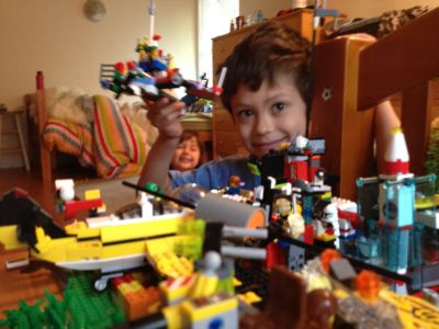 Sammy holding up a Lego creation (Sophie in background); Sunnyvale, CA, Tuesday, April 10, 2012