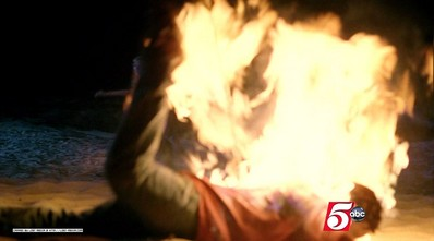 [image of someone on fire from Lost, season 5, episode 2, from lost-media.com]