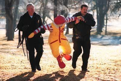 [Image: Ronald McDonald hauled off by police]