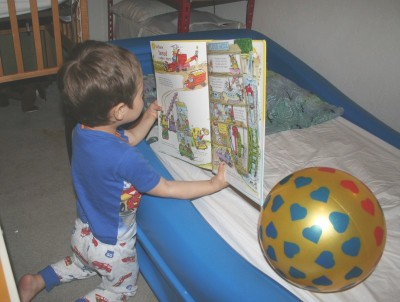 Sammy Mack in his bedroom, reading a Richard Scarry book...to his ball, Mountain View, CA, February 2, 20088