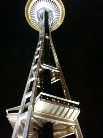 A photograph of the Space Needle in Seattle at nighttime