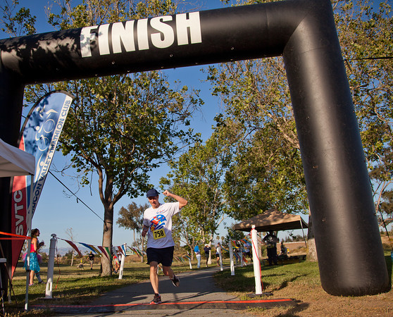 [Stephen crossing finish line of Chick Chaser 5k; Los Gatos, CA; May 10, 2013, photo by Rama, courtesy of SVTC]