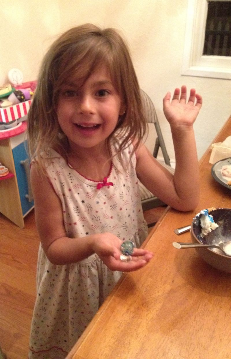Sophie in 2013, holding a bead Shannon made